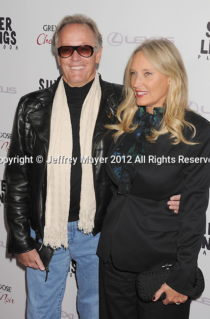 BEVERLY HILLS, CA - NOVEMBER 19: Peter Fonda and Margaret Devogelaere arrive at the 'Silver Linings Playbook' - Los Angeles Special Screening at the Academy of Motion Picture Arts and Sciences on November 19, 2012 in Beverly Hills, California.