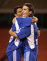 Diego Gutierrez, left and Nick Garcia, right, embrace after Kansas City's 1-0 victory over Chicago to win the US Open Cup, at Arrowhead Stadium, in Kansas City, MO, Wednesday, Sept., 22, 2004.