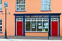 Brightly painted The Lifeboat Inn traditional bar in Courtmacsherry, West Cork, Ireland