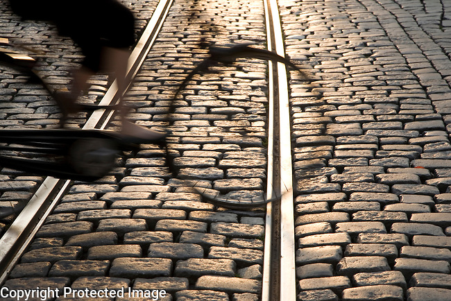 Tram tracks in Ghent with cyclist, Belgium