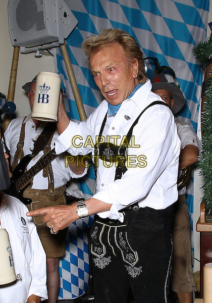SIEGFRIED FISCHBACHER.Taps the first keg to kick off Oktoberfest 2010 at the Hofbrauhaus Las Vegas, Las Vegas, Nevada, USA, 18th  September 2010..half length white shirt lederhosen german black shorts braces harness mug cup .CAP/ADM/MJT.© MJT/AdMedia/Capital Pictures.