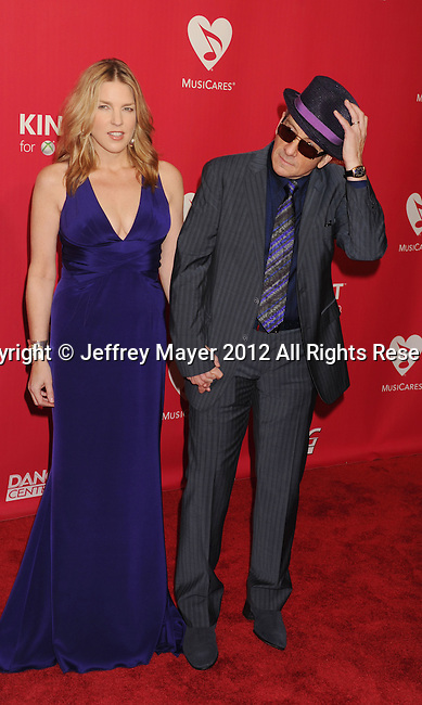LOS ANGELES, CA - FEBRUARY 10: Diana Krall and Elvis Costello  arrive at The 2012 MusiCares Person of The Year Gala Honoring Paul McCartney at the Los Angeles Convention Center on February 10, 2012 in Los Angeles, California.