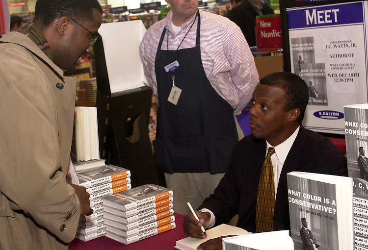 "watts2/121802 - Aaron Marshall, 31, from Upper Marlboro, MD, gets his booked signed by Rep. J.C. Watts, R-Ok., at a book store in Union Station for his new book, ""What Color is a Conservative?""."