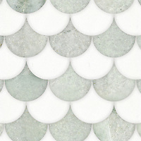 Mermaid Scales, a waterjet stone mosaic, shown in polished Thassos and Ming Green, is part of the Semplice™ collection for New Ravenna.