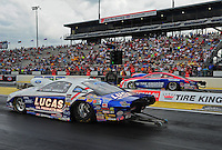 Mar. 9, 2012; Gainesville, FL, USA; NHRA pro stock driver Larry Morgan (near lane) races alongside Shane Gray during qualifying for the Gatornationals at Auto Plus Raceway at Gainesville. Mandatory Credit: Mark J. Rebilas-