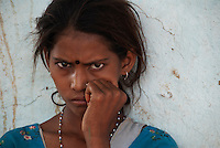 A suspicious Indian girl at a tribal village near Gwalior.