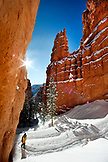 USA, Utah, Bryce Canyon City, Bryce Canyon National Park, walking through a slot canyon called Wall Street and snow covered Hoodoos, the Navajo Loop Trail
