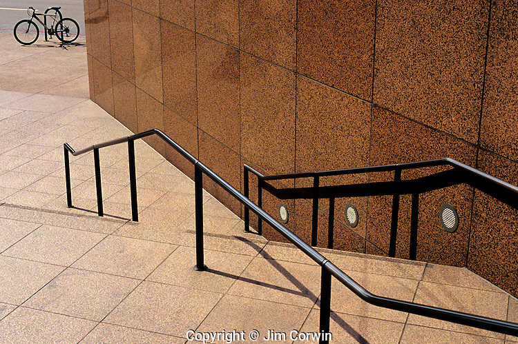 Bicycle at bottom of stairway with railing, downtown financial district, Los Angeles, California USA