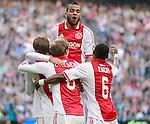 Nederland, Amsterdam, 25 maart 2012.Eredivisie .Seizoen 2011-2012.Ajax-PSV.Spelers van Ajax omhelzen Siem de Jong na zijn doelpunt