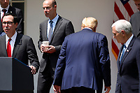 United States President Donald J. Trump leaves the podium after signing H.R. 7010 - PPP Flexibility Act of 2020 in the Rose Garden of the White House in Washington on June 5, 2020. From left to right: US Secretary of the Treasury Steven T. Mnuchin; US Secretary of Labor Eugene Scalia; the president; and US Vice President Mike Pence.<br /> Credit: Yuri Gripas / Pool via CNP/AdMedia