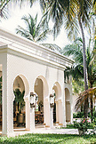 ZANZIBAR, an arched building in the Baraza Hotel under Palm Trees