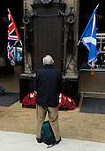 A poignant moment shortly after the 11th Hour on the 11th Day Remembrance Parade at Glasgow Central Station a traveller holds his own small remembrance at the station Memorial - picture by Donald MacLeod 11.11.10 - mobile 07702 319 738 - clanmacleod@btinternet.com - www.donald-macleod.com
