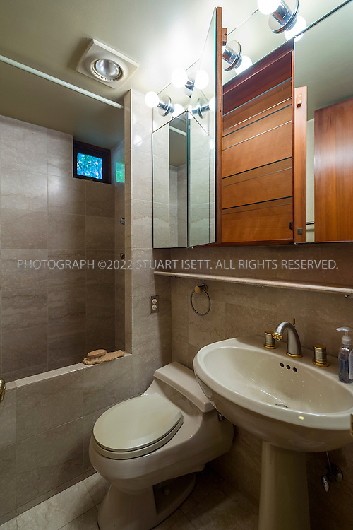 "10/9/2012--Sammamish, WA, USA..VIEW: Second bathroom...Architect Frank Lloyd Wright planned his ""Usonian"" homes to be affordable for middle-class families. The 1,9500 square foot Brandes home is for sale in Sammamish, Washington (30 minutes from Seattle) at $1.39 million. It features three bedrooms, two bathrooms and a small, separate office/study space...The home was built in 1952, and has redwood trim and Wright's original furniture and some garden sculptures by Wright. It's one of only three Frank Lloyd Wright homes near Seattle...©2012 Stuart Isett. All rights reserved."