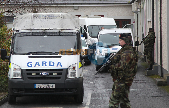 Army personnel seal of the area around Drogheda Garda Station, awaiting the arrival of a North of Ireland Prison service vehicle to transport a prisoner that was earlier brought to Drogheda Garda Station. Six army personnel carrier jeeps sealed off the Drogheda Garda station as the prisoner was transferred to the North of Ireland personal and was then given a Garda escort from Drogheda Garda Station by Army and Garda..Picture: Fran Caffrey / www.newsfile.ie ..
