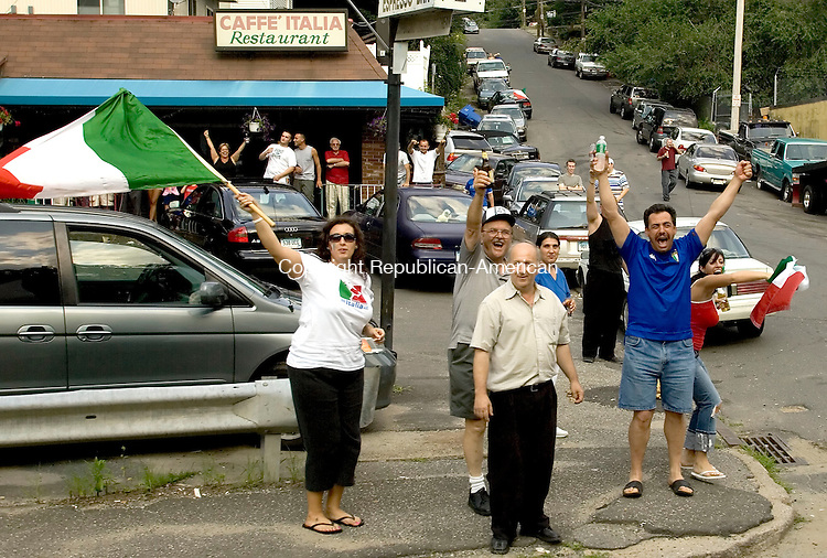 WATEBURY, CT--09 JULY 2006 -070906JS10-Italian fans celebrate their teams win over France in the World Cup finals Sunday out in front of Caffe' Italia in Waterbury  Jim Shannon Republican-American