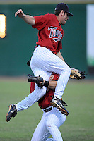 Derek McCallum Second Baseman Elizabethton Twins (Minnesota Twins) collids with Right Fielder Daniel Rohlfing after making a catch at Joe O'Brien Stadium August 17, 2009 in Elizabethton, TN (Photo by Tony Farlow/Four Seam Images)