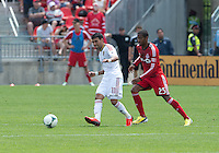 29 June 2013: Real Salt Lake midfielder Javier Morales #11 and Toronto FC defender Jeremy Hall #25 in action during an MLS game between Real Salt Lake and Toronto FC at BMO Field in Toronto, Ontario Canada.<br /> Real Salt Lake won 1-0.