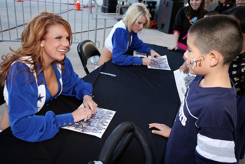 The Dallas Cowboys cheerleaders sign autographs before an AHL hockey game between the San Antonio Rampage and the Rockford IceHogs, Saturday, March 28, 2009, in San Antonio, Texas. (Darren Abate/pressphotointl.com)