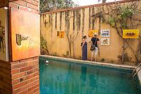 Art on Display in a Courtyard Surrounding Pool, Biannual Arts Festival, Goree Island, Senegal