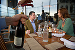 A wine bottle is uncorked for John Broomfield and Katharine Zambetti, who dine outside at Miller Union, photographed for Choice Tables on Wednesday, April 20, 2011 in Atlanta.  (Rich Addicks/Photographer) 10110950A