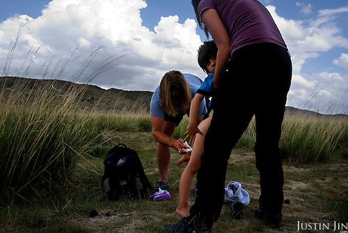 Autistic child Rowan, 5, dirties his pants in the grasslands in Mongolia. His is being cleaned by his parents Rupert and Kristin..Rowan's parents believe horses and shamans can unlock their sonís autistic mind. This is their journey of discovery across Mongolia on horseback. .The story is published by the Sunday Times and accompany text by Tim Rayment.