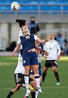 US's Rachel Buehler heads the ball next Germany's Celia Okoyino Da Mbabi during their Algarve Women's Cup soccer match at Algarve stadium in Faro, March 13, 2013.  .Paulo Cordeiro/ISI
