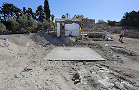 Pictured: Builders reconstruct the cesspit and part of the house -where Ben Needham disappeared from- which had to be demolished for the investigation in Kos, Greece. Friday 14 October 2016<br />