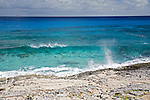 Clear blue water and waves hitting the shoreline near Stella Maris Resort on Long Island, Bahamas