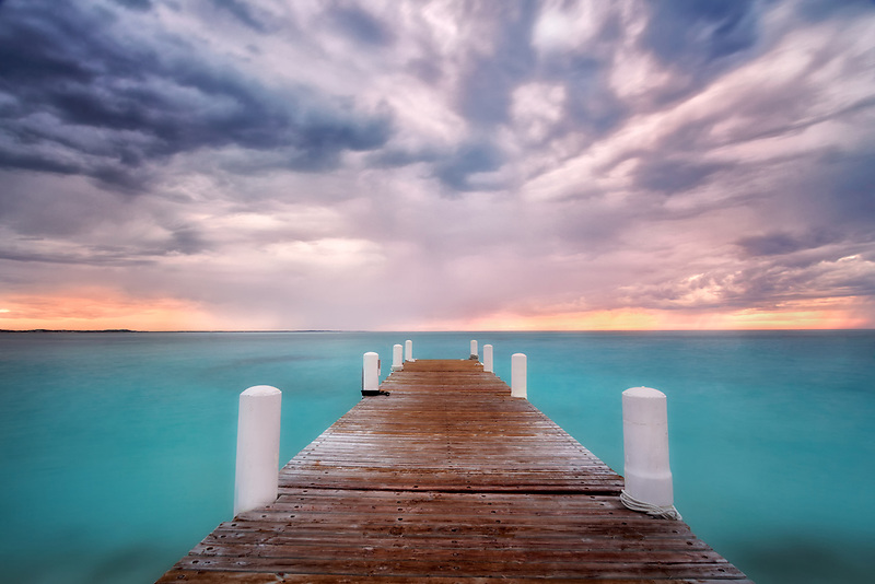 Dramatic sky and pier at sunset. Providenciales, Caicos Islands