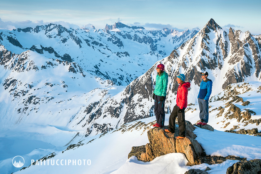 A group of friends at the Tierbergli Hut watching the sunset while on a ski tour of the Berner Haute Route, Switzerland