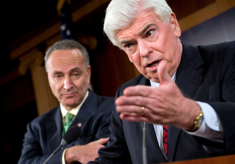 Sen. Chris Dodd, D-Conn., right, and Sen. Charles Schumer, D-N.Y., conduct a news conference on the passage of the Credit Cardholders' Bill of Rights, May 19, 2009.