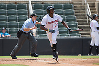Micker Adolfo (27) of the Kannapolis Intimidators starts down the first base line as he watches the flight of the baseball during the game against the West Virginia Power at Kannapolis Intimidators Stadium on June 18, 2017 in Kannapolis, North Carolina.  The Intimidators defeated the Power 5-3 to win the South Atlantic League Northern Division first half title.  It is the first trip to the playoffs for the Intimidators since 2009.  (Brian Westerholt/Four Seam Images)