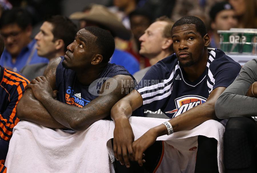 Feb. 10, 2013; Phoenix, AZ, USA: Oklahoma City Thunder forward Kevin Durant (right) and center Kendrick Perkins on the bench against the Phoenix Suns at the US Airways Center. Mandatory Credit: Mark J. Rebilas-