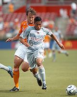 FC Dallas midfielder Ramon Nunez (10) shields the ball from Houston Dynamo defender Eddie Robinson (2).  Houston Dynamo beat FC Dallas 2-1 at Robertson Stadium in Houston, TX on June 3, 2007.