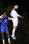 06 November 2012: UNC's Jonathan Campbell (2) heads the ball away from Duke's Sebastien Ibeagha (5). The University of North Carolina Tar Heels defeated the Duke University Blue Devils 1-0 at Fetzer Field in Chapel Hill, North Carolina in a 2012 NCAA Division I Men's Soccer game. The game was an Atlantic Coast Conference quarterfinal match.