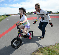 James Stevenson of Rogers (right), who has been riding since 1974, helps Eleanor Edquist, 4, of Bentonville around a section of the track Saturday, Aug. 1, 2020, during a workshop led by Stevenson at the pump track at Runway Bike Park at The Jones Center in Springdale. Stevenson and several local riders spent the morning teaching young riders how to navigate the pump track and how to position themselves on their bicycles. Visit nwaonline.com/200803Daily/ for today's photo gallery.<br /> (NWA Democrat-Gazette/Andy Shupe)