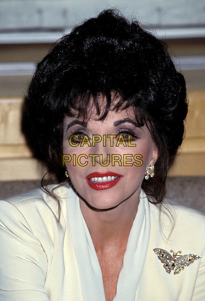 JOAN COLLINS.butterfly broach, make up.Ref: 026.www.capitalpictures.com.sales@capitalpictures.com.©Capital Pictures