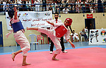 Palestinian children compete during taekwondo championship, in the West Bank city of Ramallah on August 11, 2018. Photo by Shadi Hatem
