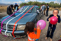 Relatives of 26 year old Tyhchtykbek start decorating his car just 30 minutess after he violently pulled a university student, Farida (20), into it and drove to his neighbourhood with her. He had met her twice before he kidnapped her. Farida was convinced by Tyhchrybek's elder sister to accept his proposal while inside the car. Although illegal, bride kidnapping is common in rural parts of Kyrgyzstan. Although illegal, bride kidnapping is common in rural parts of Kyrgyzstan. Each year around 16, 000 women become married after being kidnapped. They are known as 'Ala Kachuu' that translates as 'to grab and run away'. Defenders of the continuation of the practice sight tradition. However, during Soviet Times it was rare, and parents generally arranged marriages..