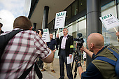 NUJ Freelance Organiser John Toner supports an NUJ protest outside the offices of; Guardian News & Media against the company's plans to stop paying freelance photographers for re-use of their pictures.