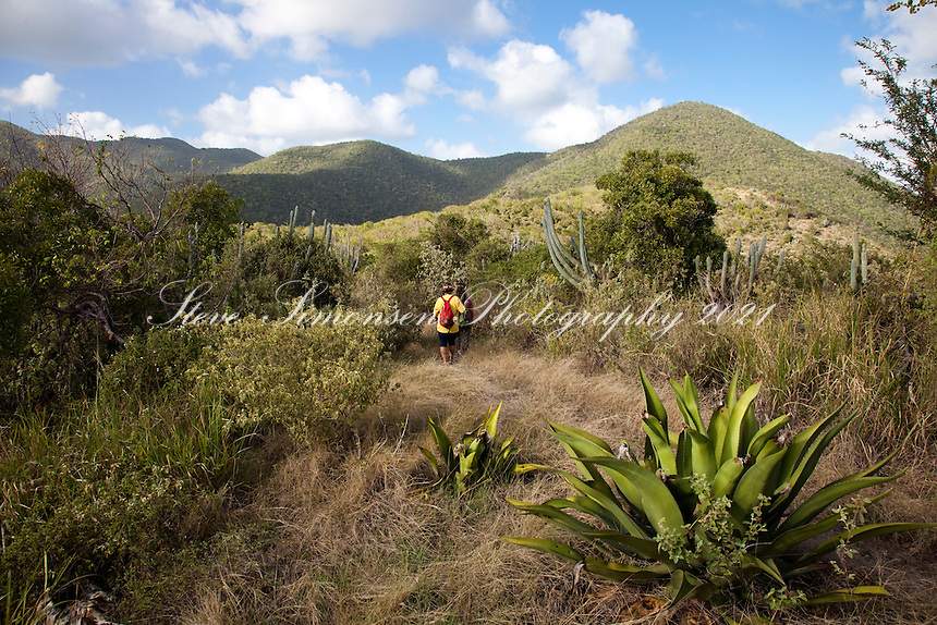 Hikers Janet Simonsen and Brooke Morton along the.Tektite trail near Lameshur Bay<br /> St John<br /> US Virgin Islands