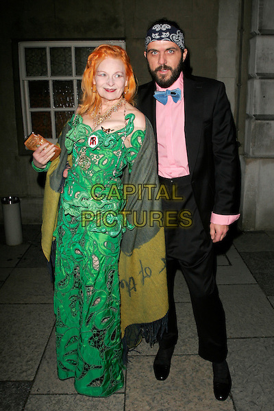 DAME VIVIENNE WESTWOOD & ANDREAS KRONTHALER.Chaos Point, in aid of NSPCC at the Banqueting House, London, England..November 18th, 2008 .full length black suit green dress married husband wife bandana beard facial hair pink shirt blue bow tie cut out away pattern shawl wrap .CAP/AH.©Adam Houghton/Capital Pictures.