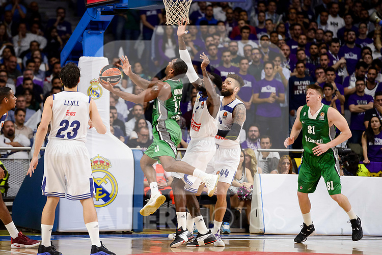 Real Madrid's Sergio Llull, Othello Hunter and Jeffery Taylor and Darussafaka Dogus's Brad Wanamaker during quarter final of Turkish Airlines Euroleague match between Real Madrid and Darussafaka Dogus at Wizink Center in Madrid, April 20, 2017. Spain.<br /> (ALTERPHOTOS/BorjaB.Hojas)