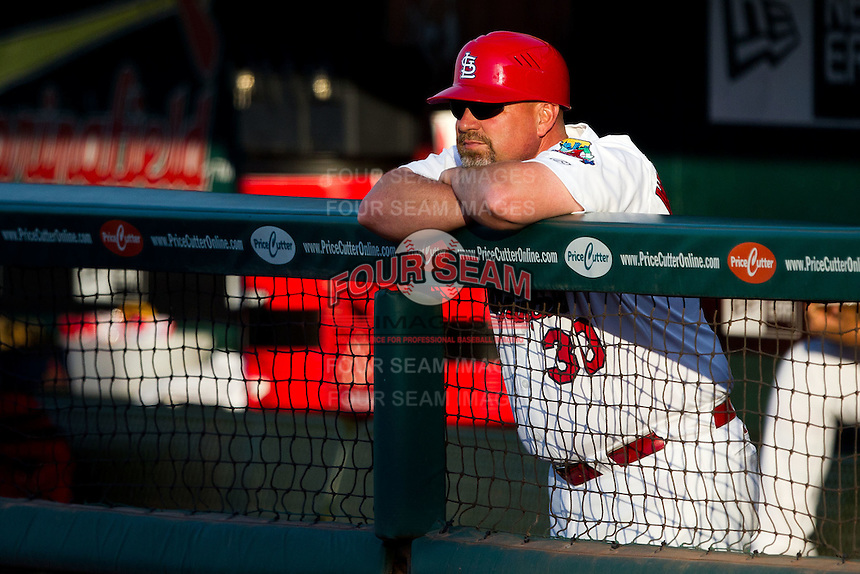 Hitting Coach Phillip Wellman (30) of the Springfield Cardinals stands in the dugout during a game against the Arkansas Travelers at Hammons Field on June 13, 2012 in Springfield, Missouri. (David Welker/Four Seam Images)