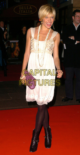 "SIENNA MILLER.At the Premiere of ""Casanova"",.Vue Cinema West End, London, England,.February 13th 2005..full length cream white dress beads necklaces purple clutch bag black tights ankle boots.Ref: CAN.www.capitalpictures.com.sales@capitalpictures.com.©Capital Pictures"