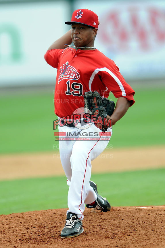 Lowell Spinners pitcher Carlos Pinales #19 during a game versus the Hudson Valley Renegades at LeLacheur Park in Lowell, Massachusetts on August 18, 2013.  (Ken Babbitt/Four Seam Images)