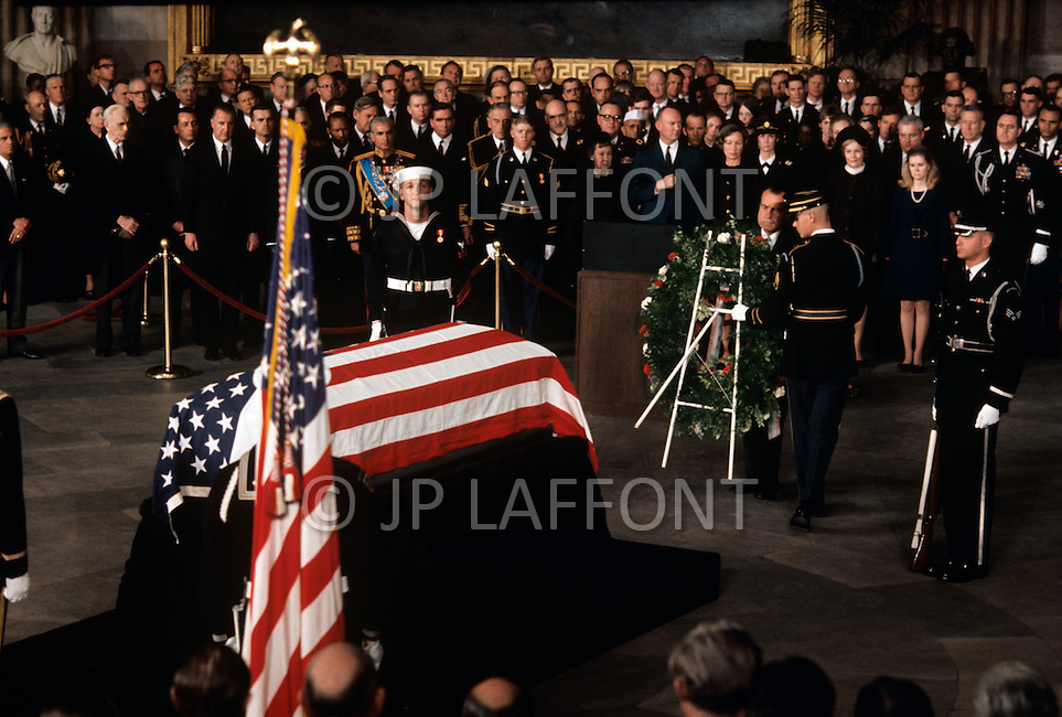 The Capitol Rotunda, Washington D.C. - March 31, 1969. United States President Richard Nixon places an ornament on the reef after delivering a eulogy for former President Dwight Eisenhower during funeral service at the National Cathedral. He (October 14, 1890 - March 28, 1969) was the 34th President of the United States from 1953 until 1961, was a five-star general in the United States Army during World War II and was the first supreme commander of NATO.