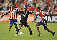 D.C. United forward Lionard Pajoy (26) goes against Chivas USA midfielder Sharlie Joseph (18)  D.C. United defeated Chivas USA 1-0 at RFK Stadium, Sunday September 23, 2012.