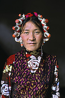 woman with head riings, Tagong, Kham, Eastern Tibet, 2005