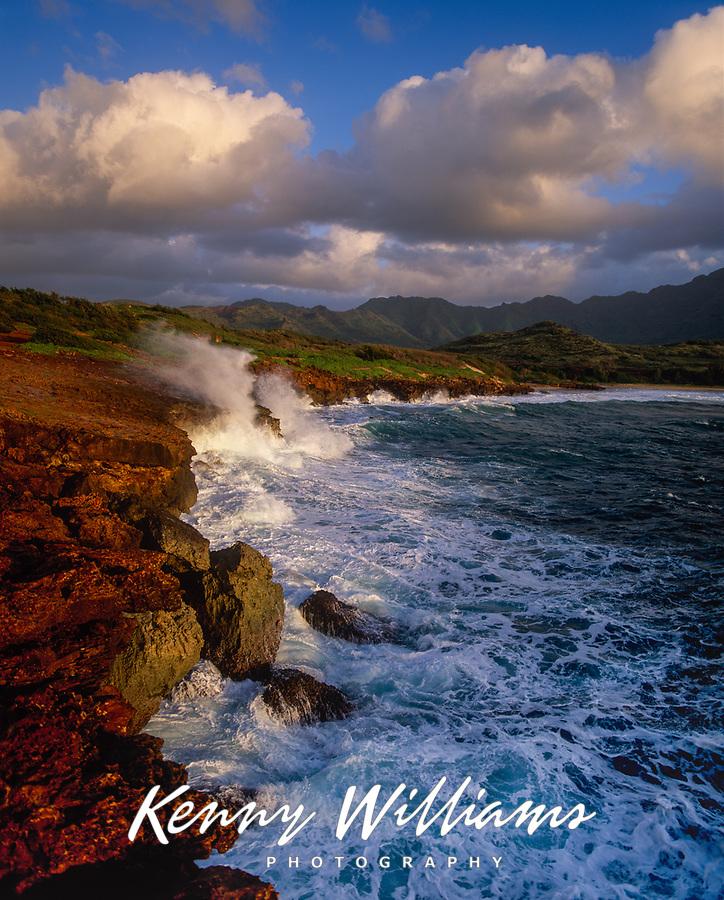 Waves crashing against Makawehi Bluff, Poipu, Kauai, Hawaii, USA.